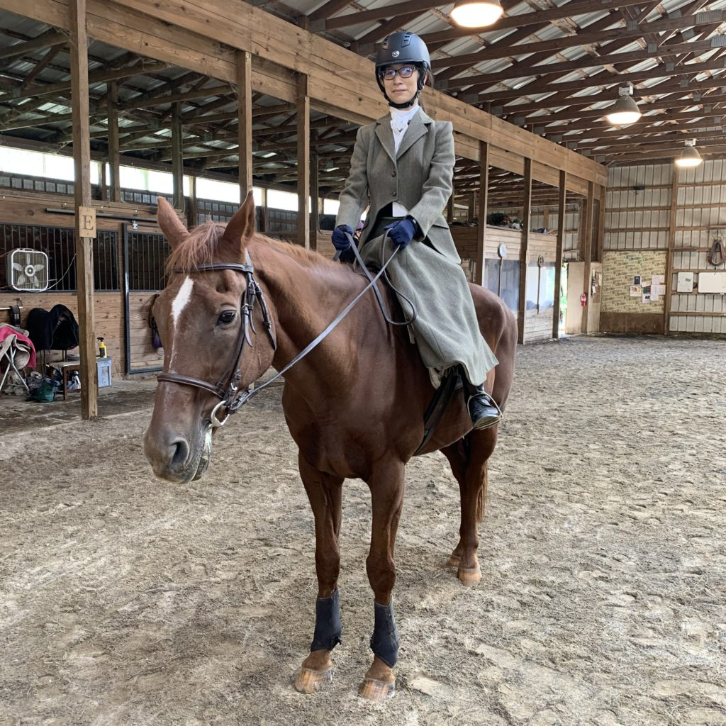 One of the participants fully dress and mounted in side saddle attire